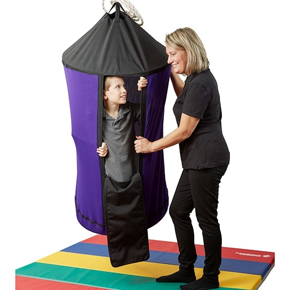 This versatile swing is great for any child who loves small places. Kids will love to swing and spin while in their own little space. Fill it with therapy balls (or any other tactile material) to increase the input and excitement. Includes a removable stabilizing bottom board, so you can provide a solid, flat floor to sit or kneel on. Each board is covered in durable fabric and attaches easily to the bottom of the swing with hook-and-loop fasteners.